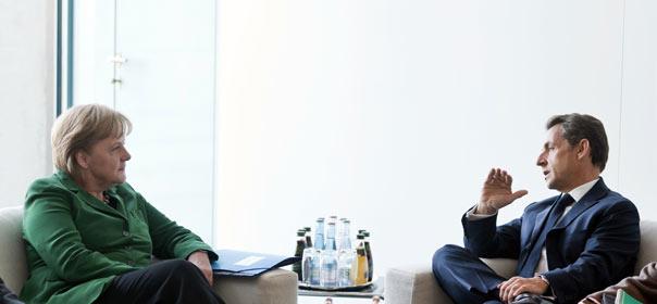 La chancelière allemande Angela Merkel et Nicolas Sarkozy, le 9 octobre 2011 à Berlin. © REUTERS.